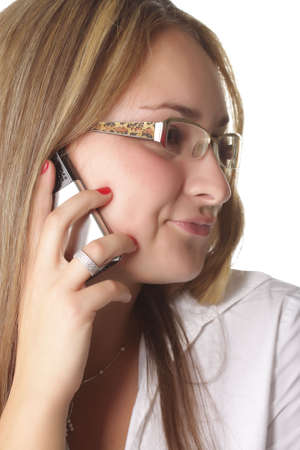 Girl talking by phone with sceptic expression photo