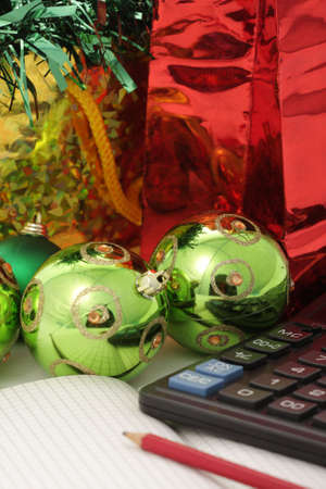 Photo of copybook pencil and calculator with christmas items on background photo