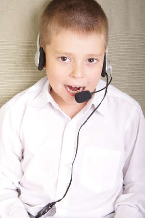 Boy in white shirt talking to headset microphone Stock Photo - 3642364