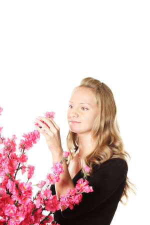 Girl with pink flowers isolated with copyspace above photo
