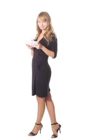Slender girl in black dress standing win letters isolated photo