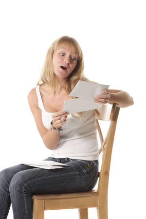 Girl looking at envelope with excited gase isolated photo