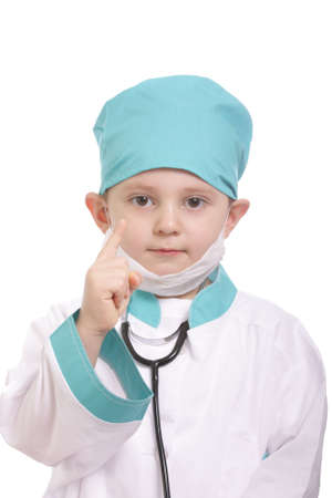 Little boy in doctor suit showing forefinger isolated