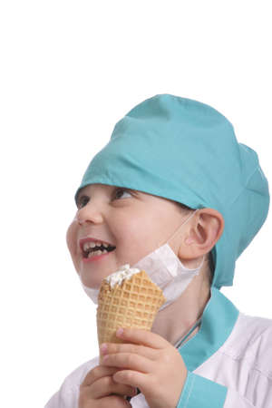 Laughing doctor with ice cream isolated over white photo