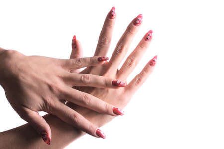 demonstrated: Hands with red nails demonstrated over white background Stock Photo