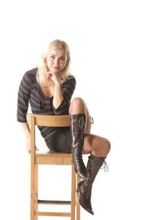 stool: Blonde on high stool over white background Stock Photo