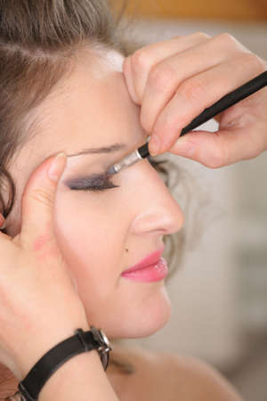 cosmetologist: Photo session backstage: cosmetologist work with model