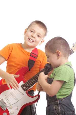 Two brothers with guitar and microphone over white background