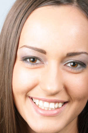 Widely smiling brunette girl face closeup photo