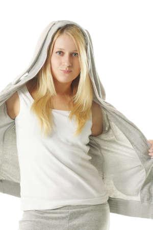 sportswoman: Pretty blonde woman in sportswear over white background