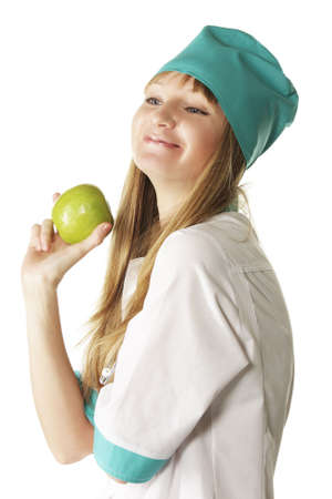 smock: Smiling doctor with green apple over white background