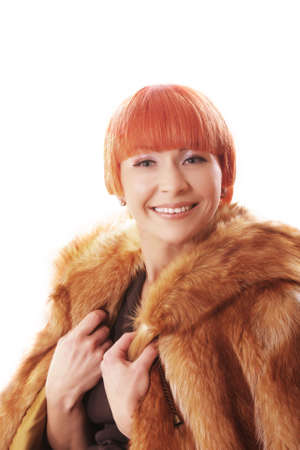 fur coat: Pretty woman in fur coat over light background Stock Photo