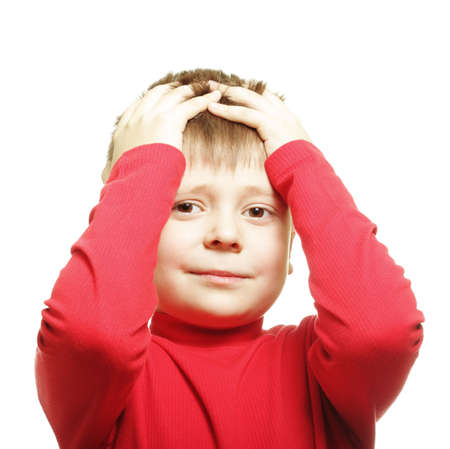 Boy in red clutching head photo over white