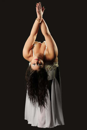 stout: Belly dancer girl photo over dark background