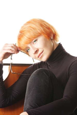 contemplated: Contemplated redhead woman sitiing on chair with glasses
