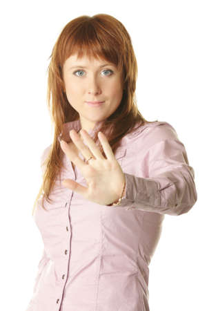 prohibitive: Young redhead woman showing prohibitive gesture