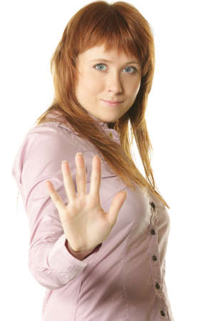 prohibitive: Redhead girl showing urging gesture photo over white background