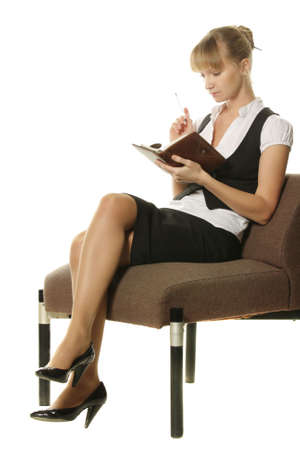 Businesswoman making notes in rusty chair over white background photo