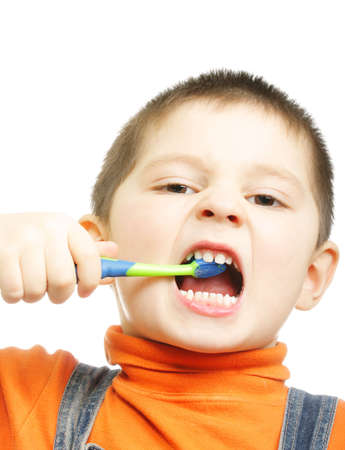 frenzy: Little boy brushing teeth with frenzy photo over white