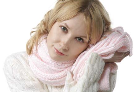 sensing: Beautiful woman sensing softnes of pink scarf with cheek
