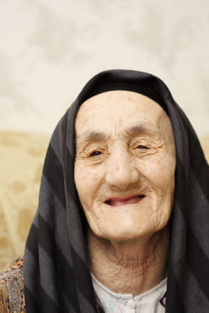Happy granny smiling head and shoulders portrait Stock Photo - 4514690