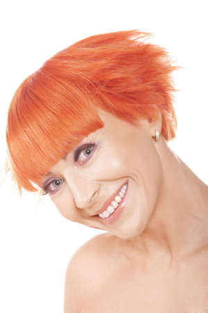 widely: Smiling widely redhead woman over white background