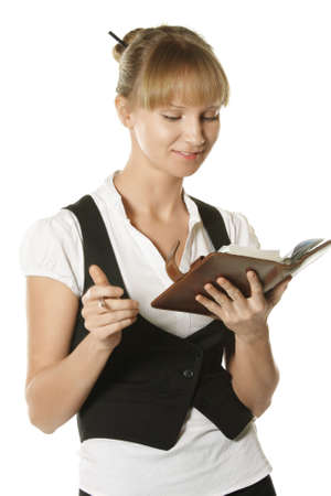 Business woman looking into nonepad and smiles Stock Photo - 4558408