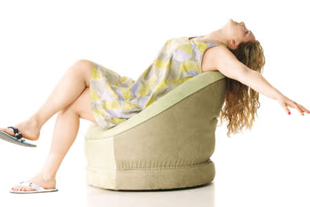 settling: Young woman dreaming flight settling back in green chair