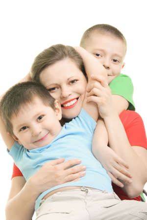 Happy brothers with smiling mummy over white background