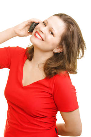 Smiling young woman in red calling by mobile over white background