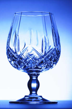 cutglass: Blue cut-glass goblet photo with highlight on background Stock Photo