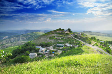 Ptikent village settled on hill side in Caucasus mountains Stock Photo - 5155719