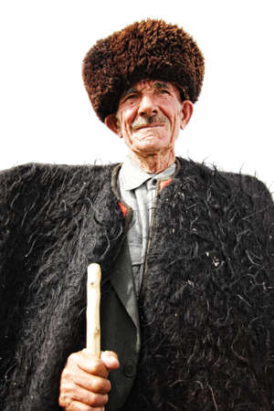 herdsman: Stately elderly herdsman in traditional clothes over white