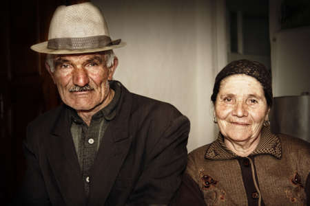 Elderly couple sitting in kitchen portrait Stock Photo - 5217441