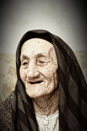 Smiling elderly woman in headscarf looking aside Stock Photo - 5240827