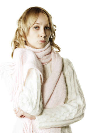 muffle: Pretty young blonde woman in sweater feeling blue  Stock Photo