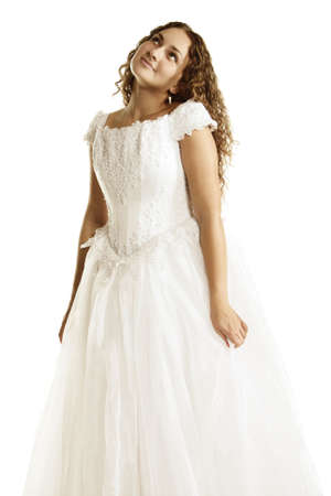 Curly bride in long dress looking up over white background Stock Photo - 5319163