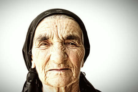 Senior woman face covered with wrinkles portrait Stock Photo