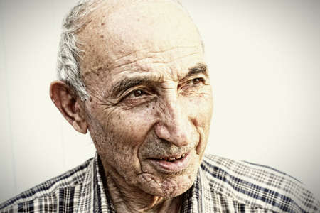 Thoughtful elderly man looking aside closeup portrait