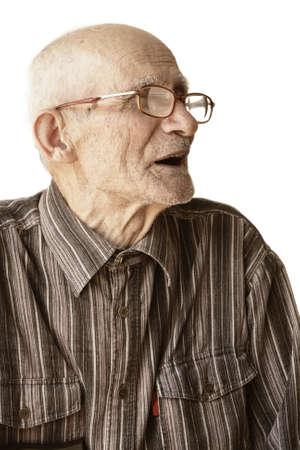 Senior man in eyeglasses sideview photo over white Stock Photo - 5384182