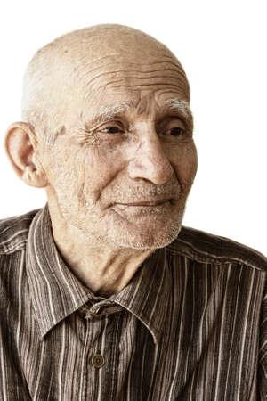 Pensive senior man portrait against white background