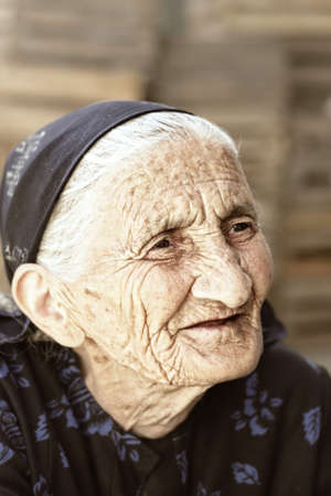Pensive senior woman looking aside outdoor portrait