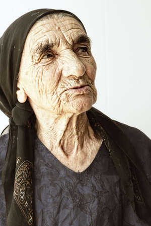 Elderly woman sideview photo over light background Stock Photo - 5384178