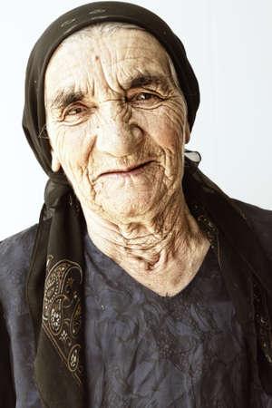 Smiling elderly woman portrait over light background Stock Photo - 5384180