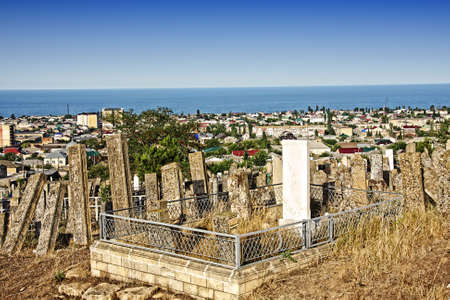 cemetry: Old moslem cemetry with Derbent cityscape on background Stock Photo