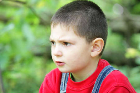 reverie: Reverie facial expression on little boy face outdoor photo Stock Photo