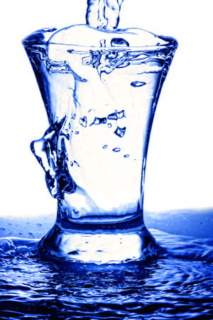 Clear water and glass against white background Stock Photo