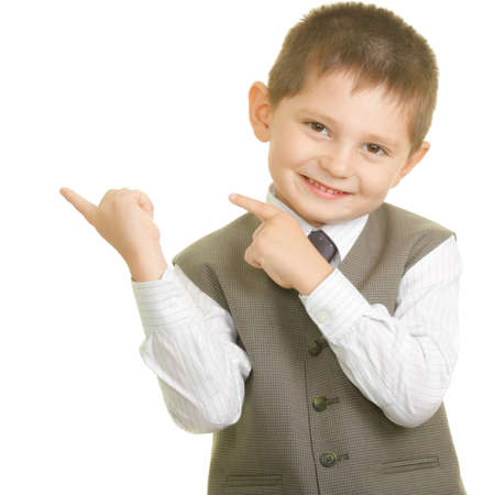 Little cute boy pointing to right with gesture photo over white