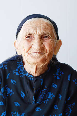 Very old woman closeup portrait against light background Stock Photo - 5638160