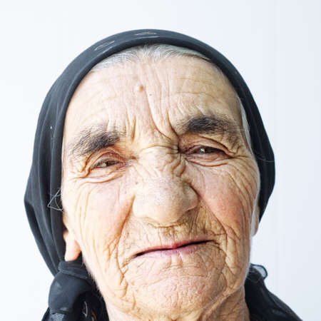 Elderly woman face portrait against light background Stock Photo - 5638155